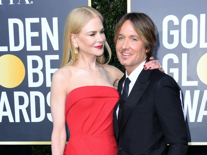 Nicole Kidman in a red dress with Keith Urban in a suit at the Golden Globes