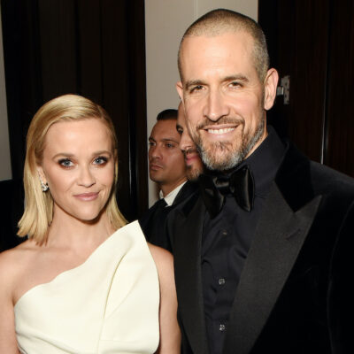 Reese Witherspoon in a white dress with Jim Toth in a black suit