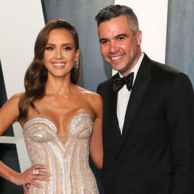 Jessica Alba in a white dress with husband Cash Warren in a tux