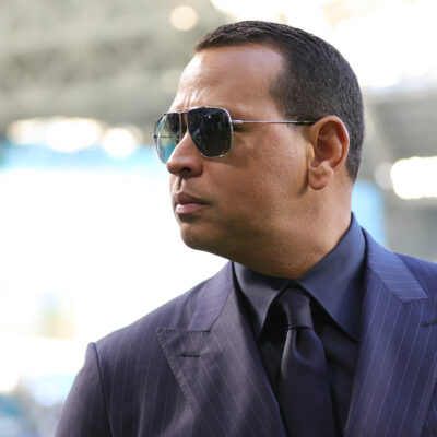 Alex Rodriguez in a black suit and sunglasses