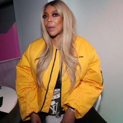 Wendy Williams talking in a yellow jacket