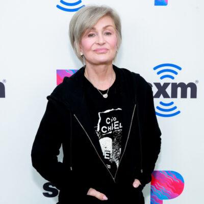 Sharon Osbourne smiling in a black hoodie