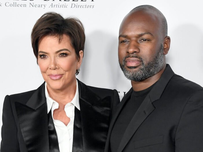 Kris Jenner and Corey Gamble in a black jackets