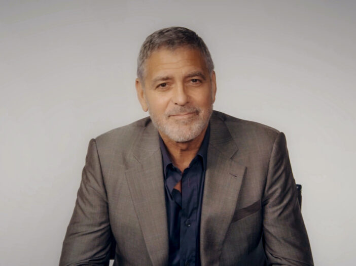 George Clooney smiling in a suit