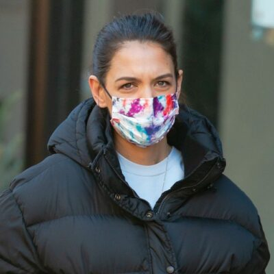 Katie Holmes in a tie dye mask and black coat