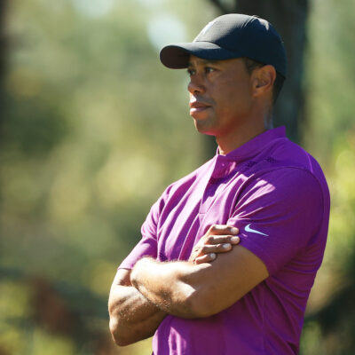 Tiger Woods in a pink shirt and black hat