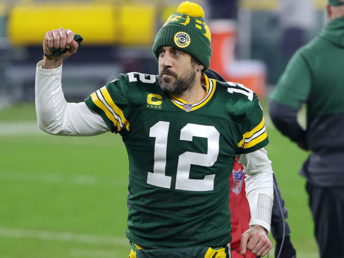 Aaron Rodgers with a raised fist in his Packers uniform