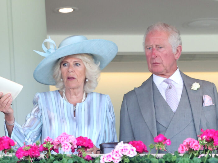 Camilla Parker Bowles and Prince Charles standing on a balcony
