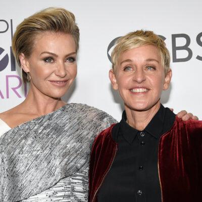 Ellen DeGeneres in a red jacket with Portia de Rossi in a white dress