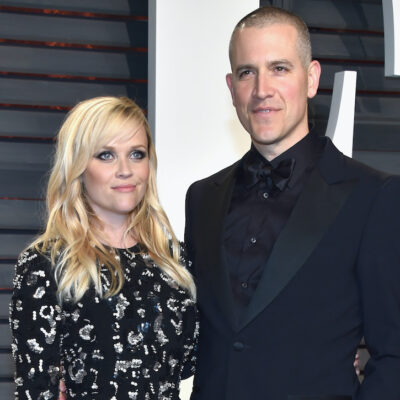Reese Witherspoon and Jim Toth in black and blue outfits