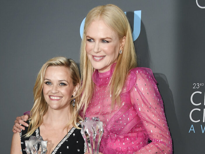 Nicole Kidman in a pink dress with Reese Witherspoon in a black dress