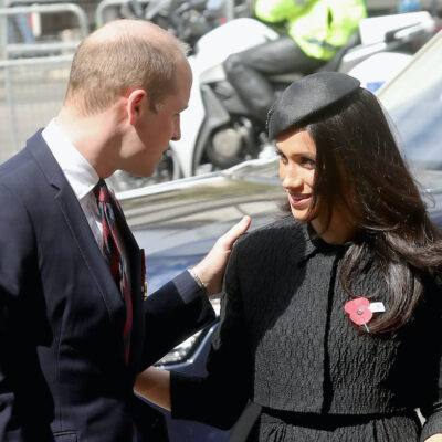 Prince William talking to Meghan Markle outdoors