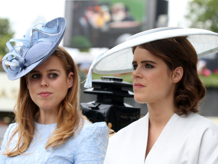 Princesses Beatrice and Eugenie smiling outdoors together