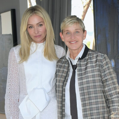 Portia de Rossi in a white outfit with Ellen DeGeneres in a plaid coat