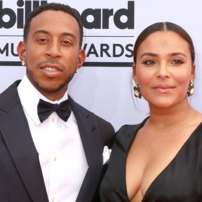 Ludacris and wife, Eudoxie Bridges at the Billboard Music Awards. He's wearing a tux, and she's wearing a black dress.