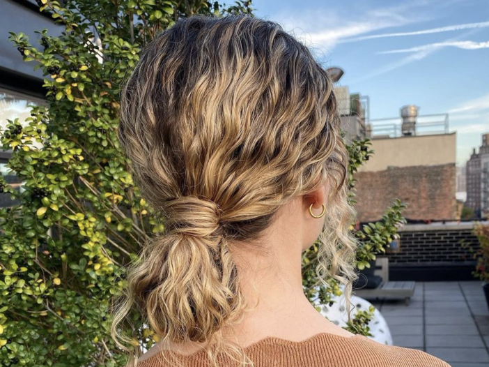 Image of hair pulled back into a low bun.