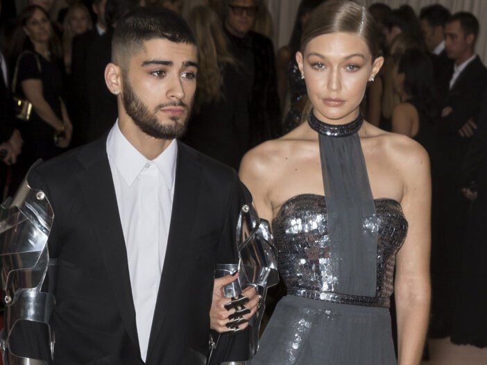 Zayn Malik on the left, Gig Hadid on the right at a red carpet event.