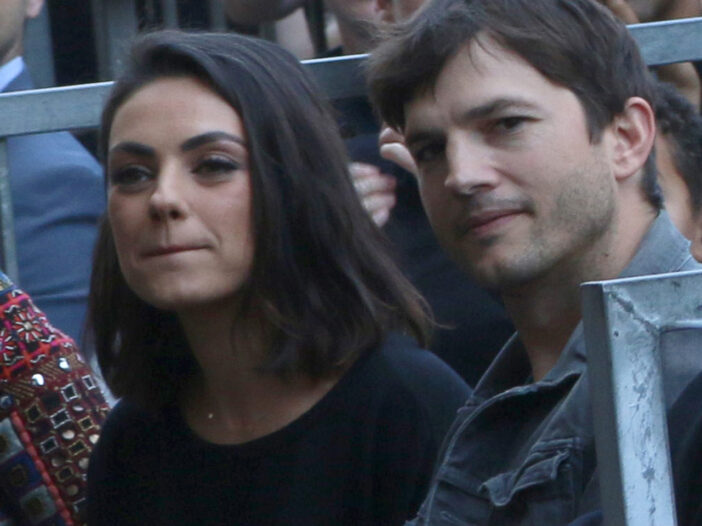 Mila Kunis on the left, Ashton Kutcher on the right, looking at the camera