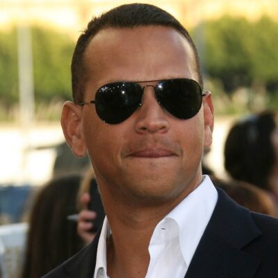 Alex Rodriguez wears a black suit and white shirt to a movie premiere