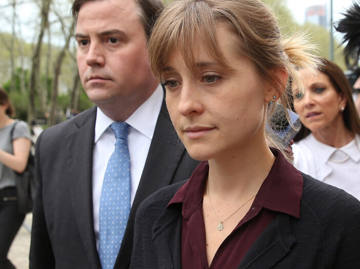 Allison Mack walking out of court.