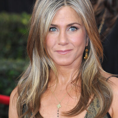 Close up of Jennifer Aniston in a gold dress