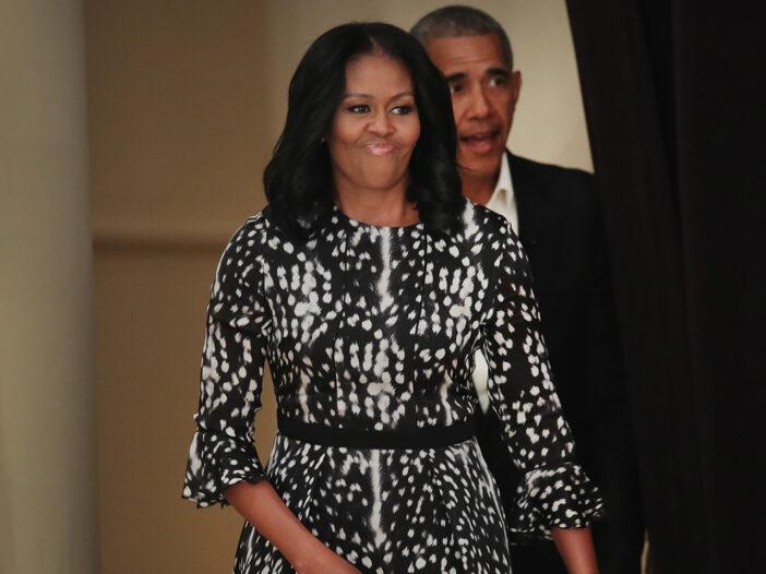 Michelle Obama leading Barack Obama