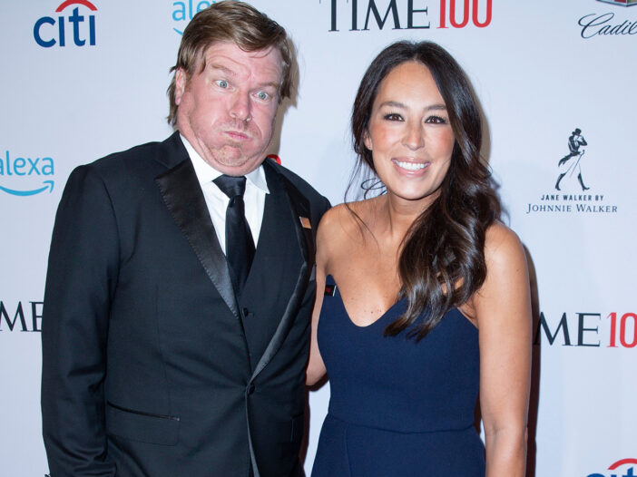Chip Gaines puffing out his cheeks, making a funny face, standing with Joanna Gaines