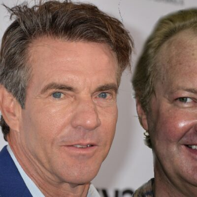 Dennis Quaid wears a blue suit on the red carpet. A separate photo of Randy Quaid is on the right