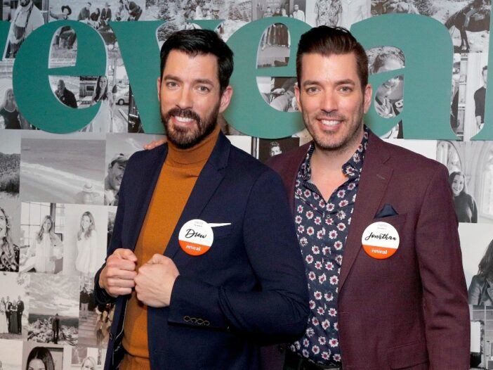 Jonathan and Drew Scott pose together at a media event