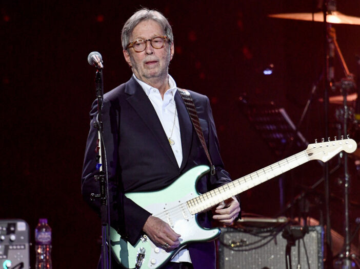 Eric Clapton playing guitar on stage in 2020