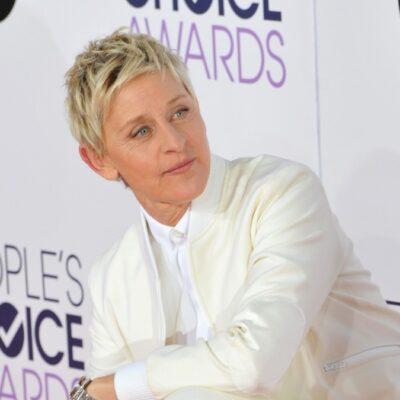 Ellen DeGeneres wears an all white suit on the red carpet