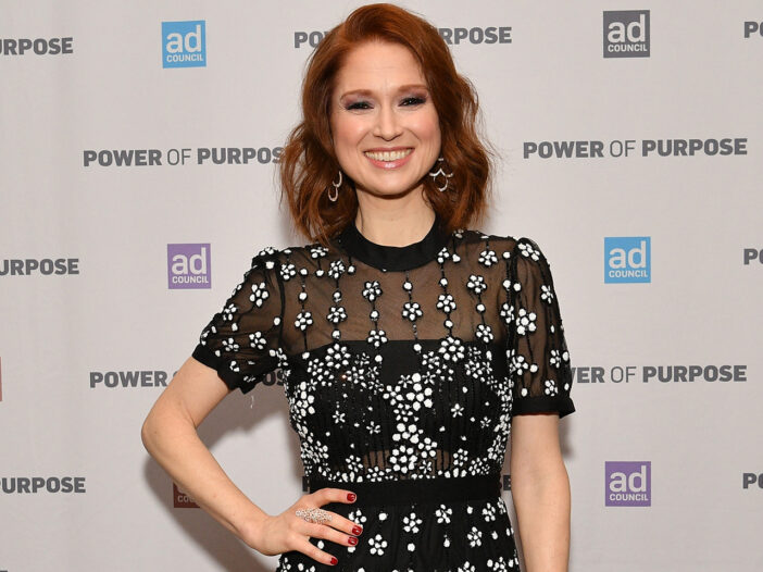 Ellie Kemper in a black, sparkly dress with her hand on her hip.
