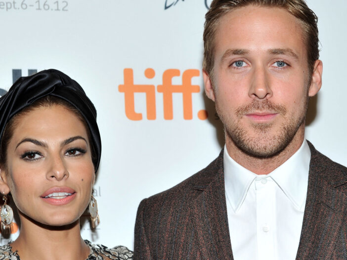 A rare photograph of Eva Mendes (left) and Ryan Gosling together at a red carpet event.