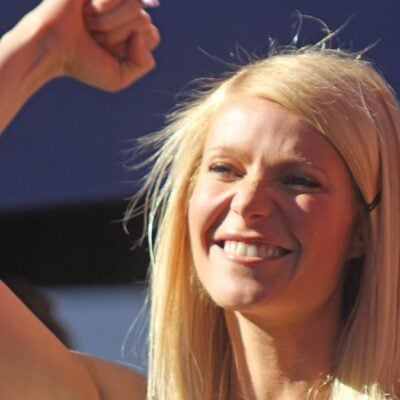 Gwyneth Paltrow raises a fist above her head at her Hollywood Walk Of Fame ceremony