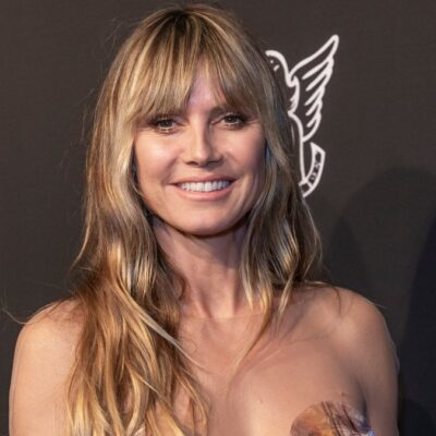 Heidi Klum wears a strapless multi colored gown on the red carpet