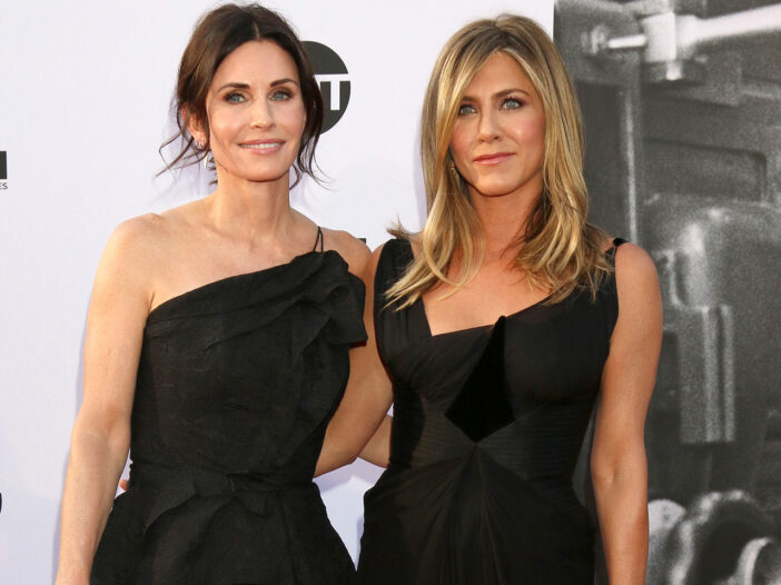 Courteney Cox on the left, standing with Jennifer Aniston.
