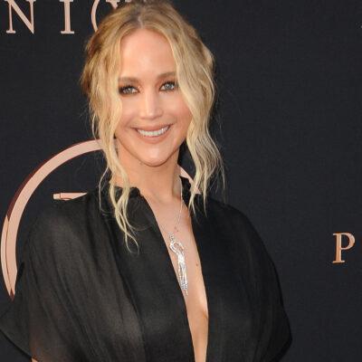 Jennifer Lawrence smiling in a black dress.
