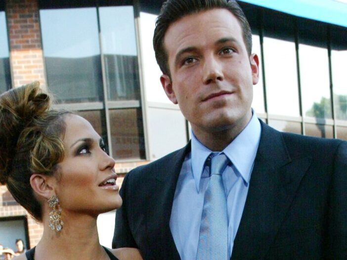 Jennifer Lopez and Ben Affleck cuddle close together at the premiere of Gigli