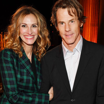 Julia Roberts smiling standing with Danny Moder