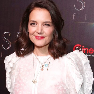 Katie Holmes smiling in a white blouse