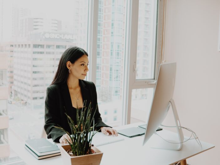 Image of woman working in office.