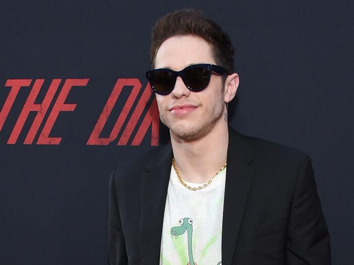 Pete Davidson at a movie premiere wearing sunglasses