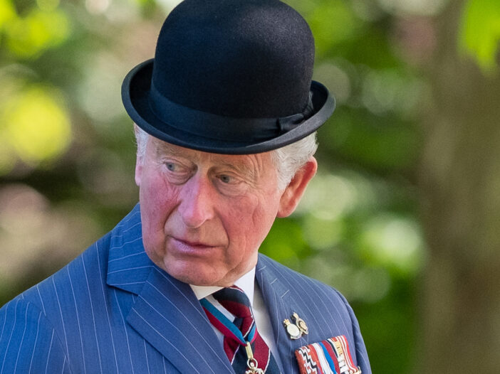 Prince Charles wearing a bowler hat