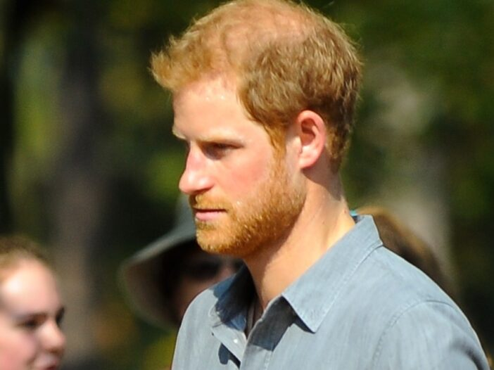 Prince Harry wears a blue shirt as he attends a royal event