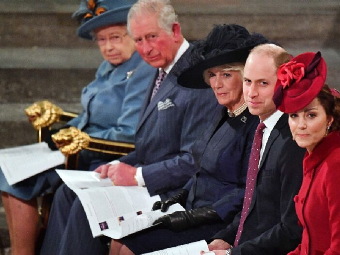 Queen Elizabeth, Prince Charles, Camilla Parker Bowles, Prince William, and Kate Middleton sit in a row in church