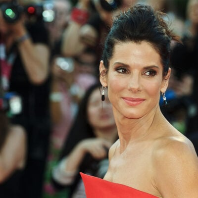 Sandra Bullock looking over her shoulder at the camera.