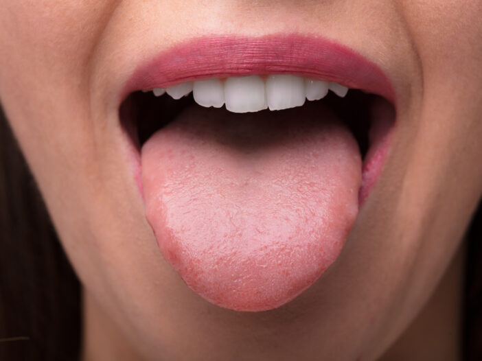 Image of woman stick out her tongue.