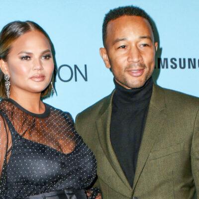John Legend in a green suit and Chrissy Teigen in a black dress