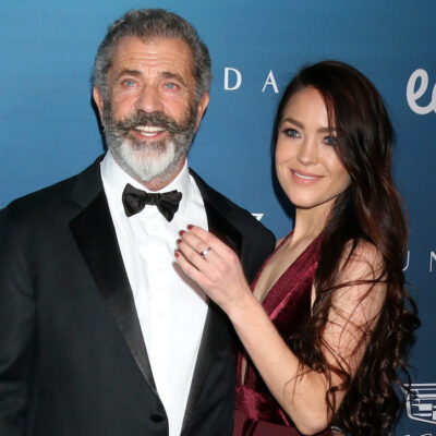 Mel Gibson smiling in a tuxedo with Rosalind Ross