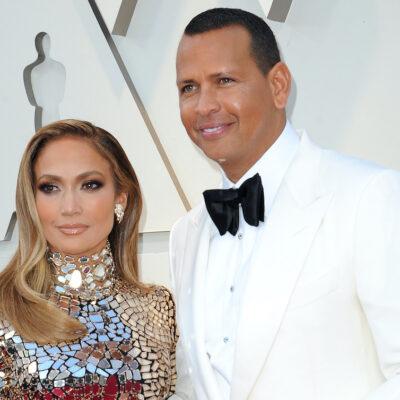 Jennifer Lopez in a silver dress with Alex Rodriguez in a white tuxedo
